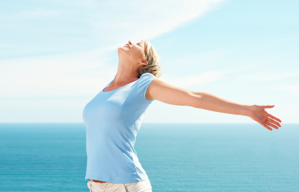 Mature woman with hands outstretched , pleasant feeling