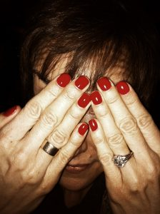 Woman Hiding Behind Manicure