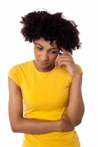 """Calm And Thoughtful Curly Haired Young Woman"" by stockimages"