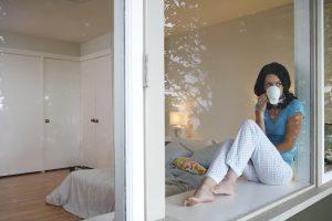 iStock_lady drinking coffee bedroom