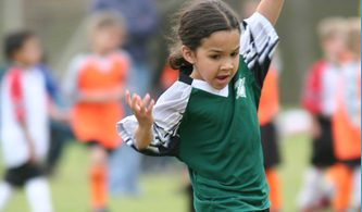 A young girl playing in a soccer league